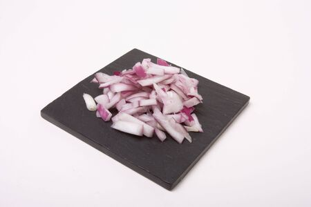 Chopped Onions on background of dark grey/black slate. Stock Photo - 6486943