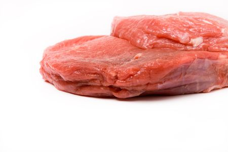 raw beef: Heap of Raw Beef isolated against white background from low viewpoint.