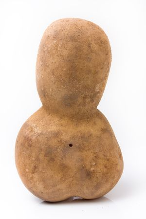 spud: Funny potato shaped like a little mans head and body leaning forwards against white background.