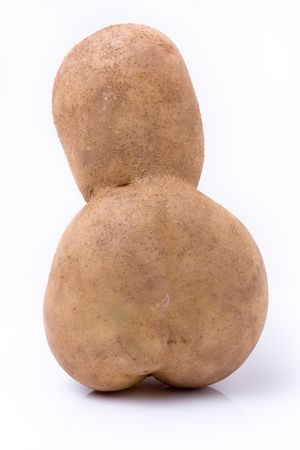 Funny potato shaped like a little mans head and body rear view against white background. Stock Photo