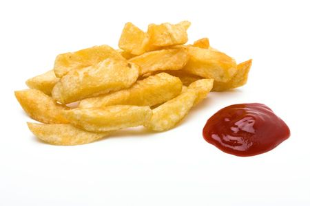 English Chip shop chips isolated against white background with portin of tomato ketchup. Stock Photo