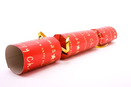 Red Christmas Cracker shot from low viewpoint with shallow focus against white background. Stock Photo - 6566459