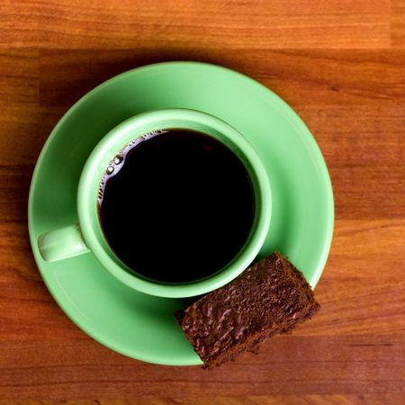 elevenses: Chocolate fudge brownie with cup of espresso coffee