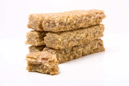 Flapjack oat cake biscuit stack  isolated against white background. Stock Photo - 6641023