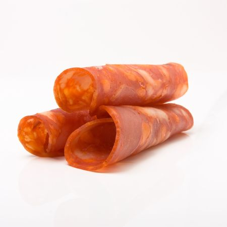Rolled Chorizo Slices isolated against white background. Stock Photo - 6686503