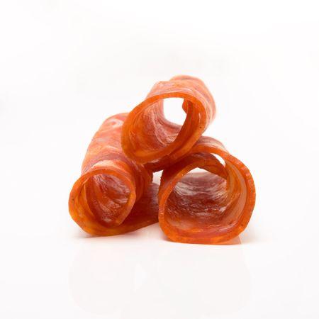 Rolled Chorizo Slices isolated against white background. photo