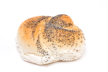 Seeded bread roll from low viewpoint isolated against white background. photo