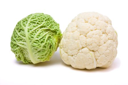 Cabbage and cauliflower close up from low viewpoint against white background. photo