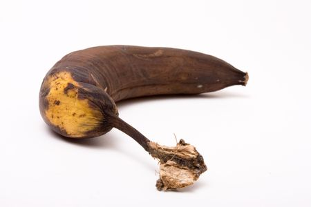 Brown Over Ripe Banana isolated against white background. photo