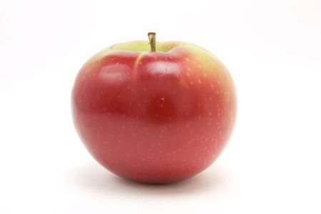 Red apple from low viewpoint isolated against white background.