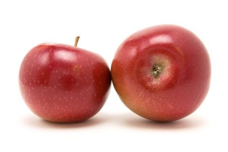 Red apple from low viewpoint isolated against white background. photo