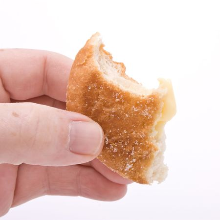 Hand holding half eaten donut against white background. Stock Photo - 6828142