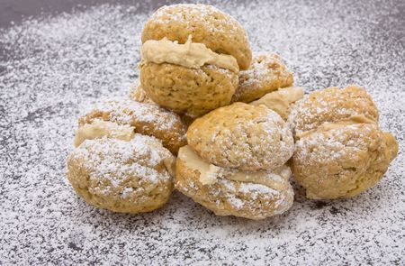 kiss biscuits: Coffee Kiss Biscuits with dusting of icing sugar and butter cream filling.