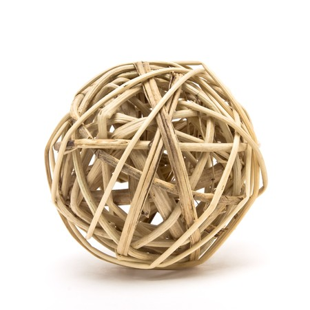 entwined: Woven wickerwork ball made from bamboo, reed or willow isolated against white background.