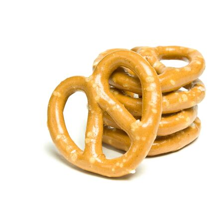 Stack of Pretzels tower isolated against white background. photo