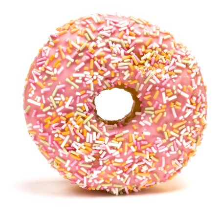 pink and brown: Pink Iced Doughnut covered in sprinkles isolated against white background. Stock Photo
