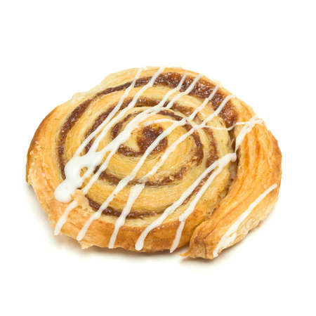 Cinnamon Danish Pastry swirl isolated against white background photo