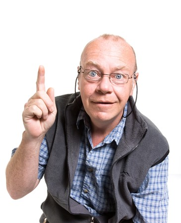 Expressive old man pointing isolated against white background. photo