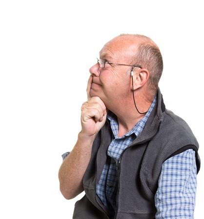 Expressive old man thinking isolated against white background. Stock Photo - 7118509