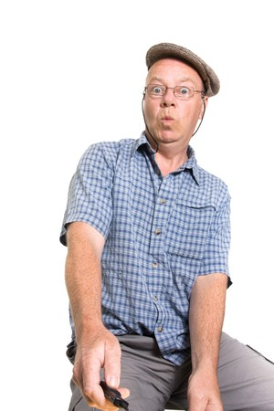 Expressive old man operating remote switch isolated against white background. photo