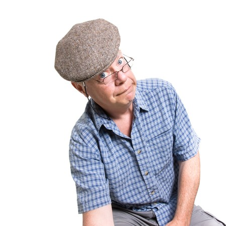 daft: Expressive old man looking daft isolated against white background.