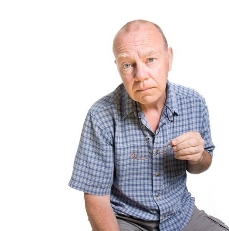 Expressive old man looking serious isolated against white background. photo