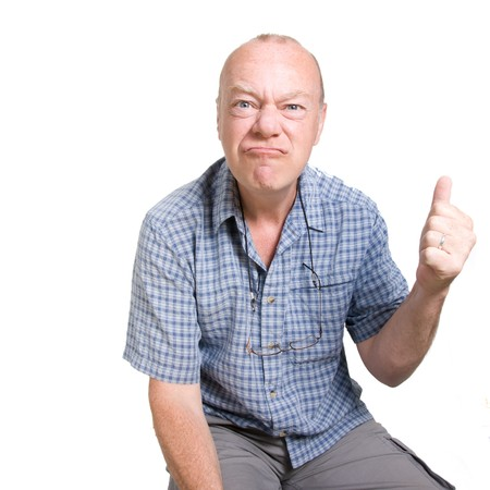 Expressive old man looking aggressive isolated against white background. photo