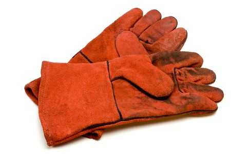 low perspective: Coarse leather welders gloves from low perspective isolated against white background.