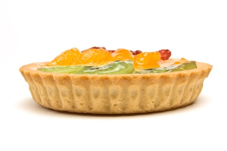 Custard filled tart topped with summer fruits of Strawberry, mandarin orange and kiwi fruit. Stock Photo - 7331226