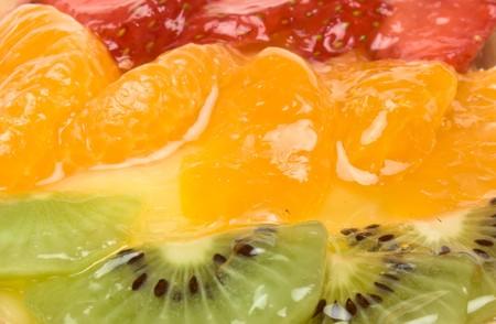 Custard filled tart topped with summer fruits of Strawberry, mandarin orange and kiwi fruit. Stock Photo - 7331178