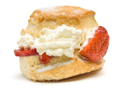 Cream Scone with strawberry from low perspective isolated against whitebackground. photo