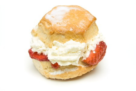 Cream Scone with strawberry from low perspective isolated against whitebackground. Stock Photo - 7331263