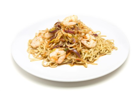 Prawn Stir fry on white plate isolated against white background. photo