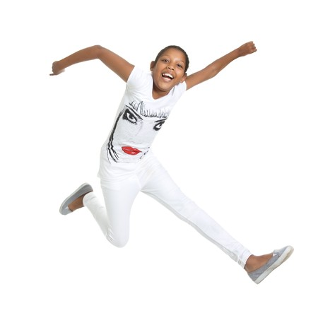 yong: beautiful mixed race yong girl leaping and jumping isolated against white background. Stock Photo