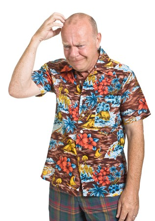 hawaiian shirt: Expressive old man in loud shirt holiday concept isolated against white.