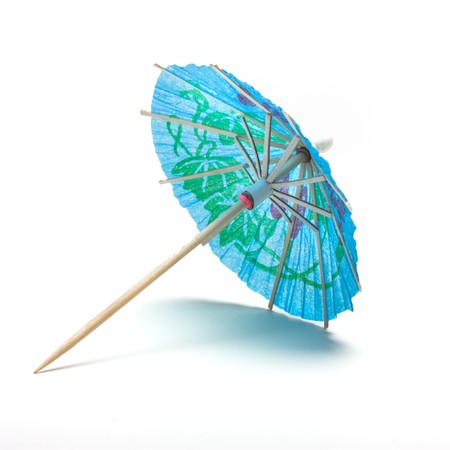 cocktail umbrella: Cocktail Umbrella from low perspective isolated against white background.