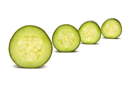Cucumber abstract from low perspective isolated against white. photo