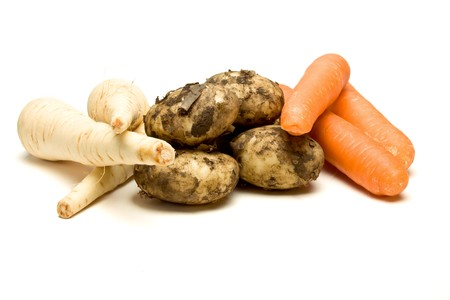 low perspective: Three root vegetables from low perspective isolated against white background.