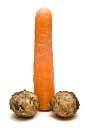 Symbolic phallic concept image of carrot and two Potatoes isolated against white background. Stock Photo - 7430988