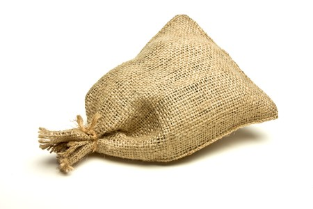 Hessian sack tied with string from low perspective isolated against white background.