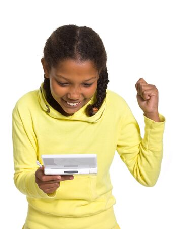 Young mixed race girl with handheld video game isolated against white. photo