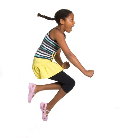 Expressive Young Mixed Race Girl leaping and jumping isolated against white background. Stock Photo - 7475479