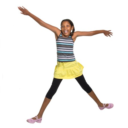 Expressive Young Mixed Race Girl leaping and jumping isolated against white background. photo