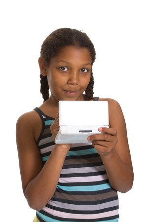 Expressive Young Mixed Race Girl gaming isolated against white background. Stock Photo - 7477195