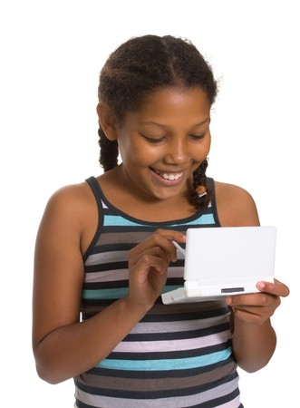 Expressive Young Mixed Race Girl gaming isolated against white background. photo
