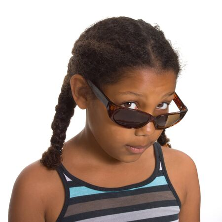 Expressive Young Mixed Race Girl wearing sunglasses isolated against white background. Stock Photo - 7475460