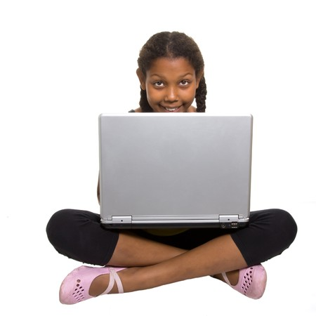 Expressive Young Mixed Race Girl cross legged with laptop isolated against white background. Stock Photo - 7477189