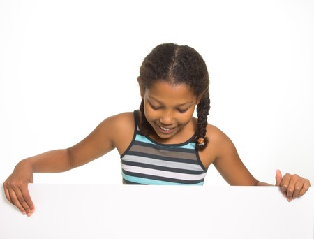 Expressive Young Mixed Race Girl holding board isolated against white background. Stock Photo