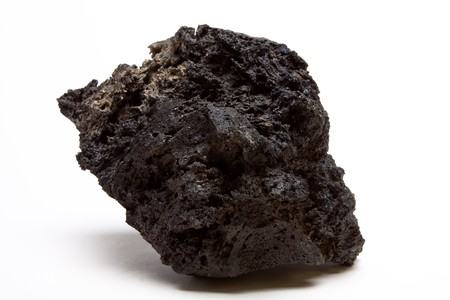 igneous: Abstract chunk of Lava Rock from low perspective isolated against white. Stock Photo