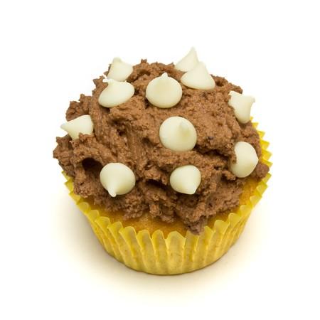 Home made milk chocolate cupcake with white chocolate drop decoration. Stock Photo - 7588877